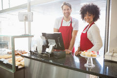 Portrait of colleagues posing behind the counter. At the bakery royalty free stock photos