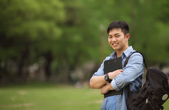 Portrait college student. College student holding book on the park Stock Photo