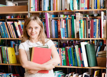 Portrait of a college student in library Royalty Free Stock Photos