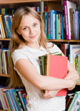 Portrait of a college student in library.  Stock Images
