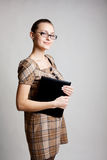 Portrait of a college student or teacher. Portrait of a young woman, college student or teacher stock photography
