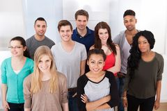 Portrait of college students standing in classroom Stock Photo