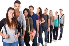 Portrait of college students standing in a line. Portrait of multiethnic college students standing in a line over white background Stock Image