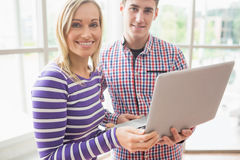 Portrait of college students using laptop Royalty Free Stock Images