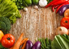 Composition with fresh raw vegetables. Portrait of Composition with fresh raw vegetables on rustic wooden table Royalty Free Stock Photos