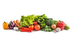 Composition with raw vegetables. Portrait of Composition with raw vegetables isolated on white Royalty Free Stock Images
