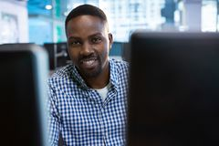 Portrait of computer engineer sitting at desk. In office Stock Image
