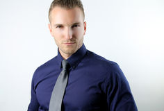 Portrait of a conceited man. Handsome pretentious businessman on a white background royalty free stock photos