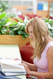 Portrait of a concentrated female student working Stock Photo