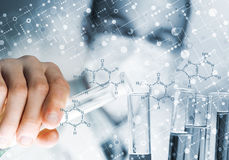 Portrait of concentrated male scientist working with reagents in laboratory Royalty Free Stock Images