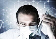 Portrait of concentrated male scientist working with reagents in laboratory Royalty Free Stock Photo