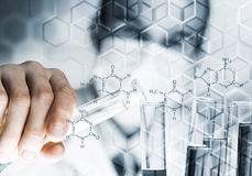Portrait of concentrated male scientist working with reagents in laboratory Stock Images