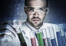 Portrait of concentrated male scientist working with reagents in laboratory Stock Photography