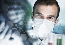 Portrait of concentrated male scientist working with reagents in laboratory Stock Image