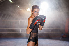 Boxing blonde sportswoman on ring Royalty Free Stock Image