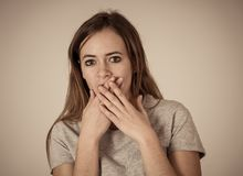Portrait of concern shocked teenager girl with frightened gestures. Scared face, shocked emotion stock photo