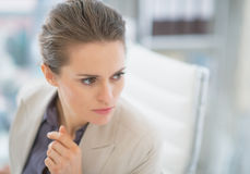 Portrait of concerned business woman in office. Portrait of concerned business woman in modern office Royalty Free Stock Images
