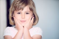 Portrait of a concerned little girl stock photography