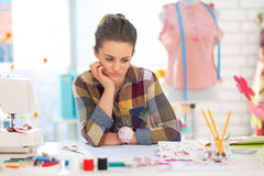 Portrait of concerned seamstress in studio Royalty Free Stock Photography