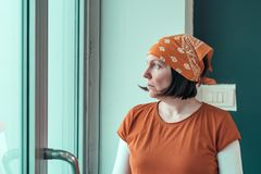 Portrait of concerned self employed female carpenter. Looking out through the window of her small business woodwork workshop royalty free stock photography