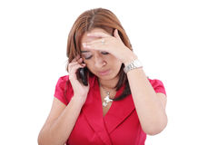 Concerned woman talking mobile phone Stock Image