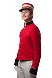 Portrait of a concierge (porter). In a red jacket on a white background. Isolated on white Stock Image