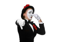 Portrait of the condemning mime. Portrait of the condemning woman as mime with dissatisfaction with a grimace on his face isolated on white background. Concept Royalty Free Stock Images