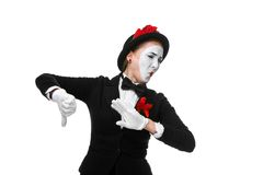 Portrait of the condemning mime. Portrait of the condemning woman as mime with dissatisfaction with a grimace on his face isolated on white background. Concept Stock Photos