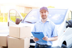 Portrait of confidence express courier and delivery van Royalty Free Stock Image