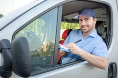 Portrait of confidence express courier driving his delivery van Royalty Free Stock Images