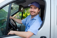 Portrait of confidence express courier. Driving his delivery van stock photo