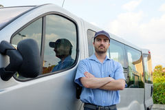 Portrait of confidence express courier. Next to his delivery van royalty free stock photos