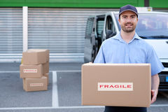Portrait of confidence express courier. Next to his delivery van royalty free stock photography