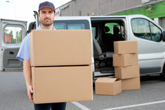 Portrait of confidence express courier. Next to his delivery van Stock Photography