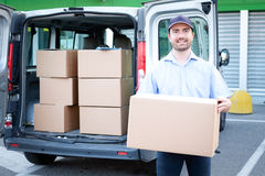 Portrait of confidence express courier. Next to his delivery van stock photo