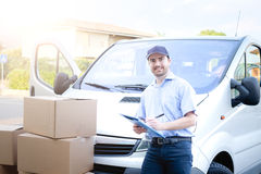 Portrait of confidence express courier. Next to his delivery van stock photos