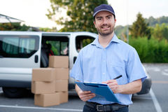 Portrait of confidence express courier. Next to his delivery van Stock Images