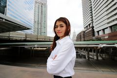 Portrait of confident Asian businesswoman standing and looking at camera against urban building city background. Leader woman busi. Ness concept stock photography