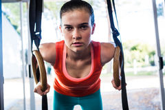 Portrait of confident athlete holding gymnastic rings Stock Photo
