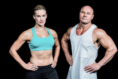 Portrait of confident athlete man and woman with hands on hip Stock Photo