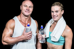 Portrait of confident athlete man and woman with water bottle Stock Images