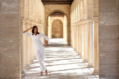 Confident happy mature woman historic archway Royalty Free Stock Images