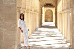 Confident sexy mature woman standing archway Royalty Free Stock Photos