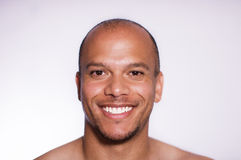 Portrait of a confident and attractive mixed race man smiling to camera Royalty Free Stock Photography