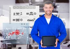 Portrait of a confident automobile mechanic holding digital tablet. Digital composition of a confident automobile mechanic holding digital tablet and mechanic Royalty Free Stock Images