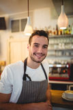 Portrait of confident barista at cafeteria. Portrait of confident handsome barista at cafeteria Royalty Free Stock Photo