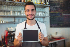 Portrait of confident barista holding blank chalkboard Royalty Free Stock Photos