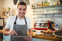 Portrait of confident barista using digital tablet at cafe Royalty Free Stock Photos