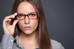 Portrait of confident beautiful woman with eyeglasses. Stock Photography