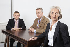 Portrait of confident business group at desk in office Royalty Free Stock Photography